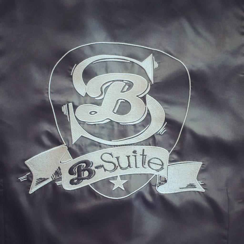 bordado en chaleco grupo música b-suite